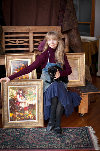 Nancy Guzik in her studio with Max the cat!