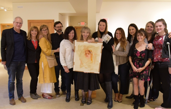 Artists with Richard's portrait sketch of Symi Jackson