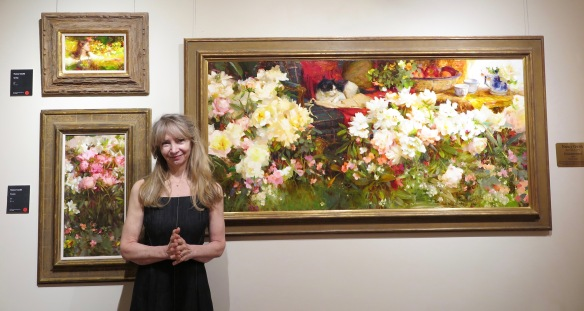 "Nancy Guzik with her oils in the show plus, ""Enchantment gifted to the Laumeister Art Center in memory of Captain John Adams. jpg"